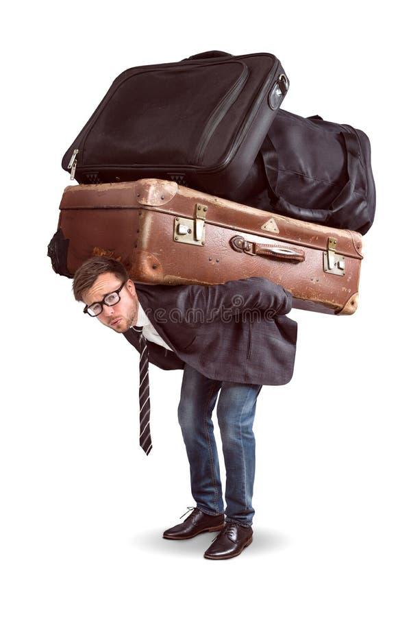 Hombre con equipaje pesado foto de archivo libre de regalías