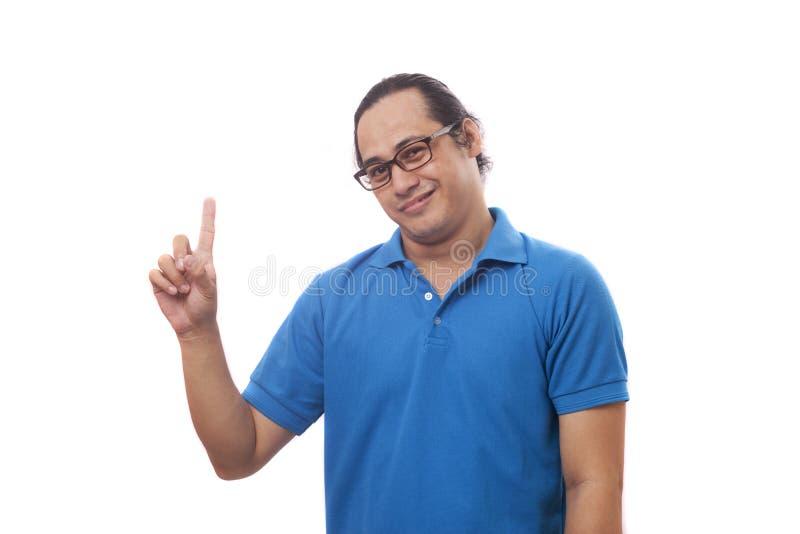 Hombre con gesto del finger de la muestra del número uno foto de archivo