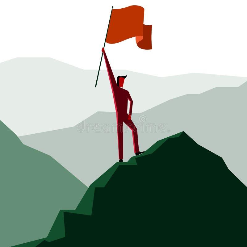 Hombre con la bandera en un pico de montaña fotografía de archivo