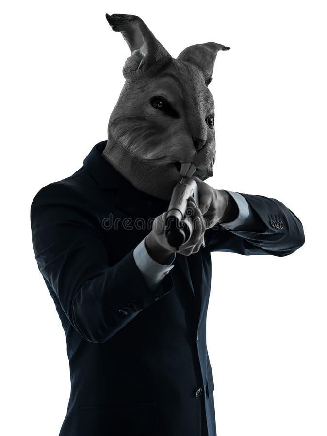 Hombre con la caza de la máscara del conejo con el retrato de la silueta de la escopeta imagen de archivo