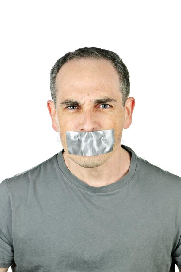 Hombre con la cinta del conducto en boca foto de archivo libre de regalías