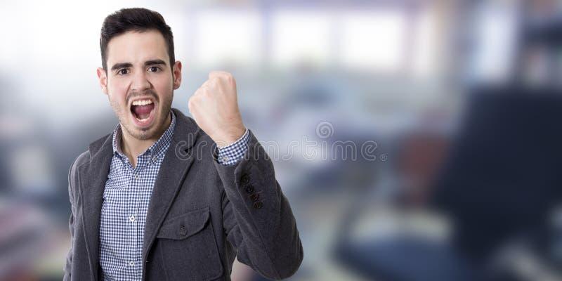 Hombre con la expresión del éxito imagen de archivo