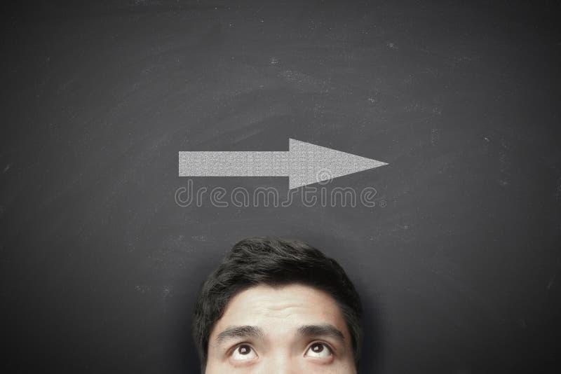 Hombre con la flecha imagen de archivo libre de regalías