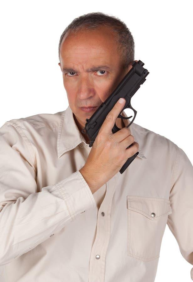 Hombre con la pistola imagen de archivo
