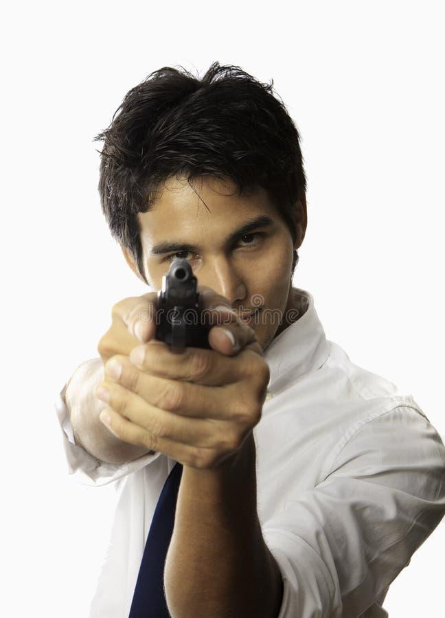 Hombre con la pistola automática fotografía de archivo libre de regalías