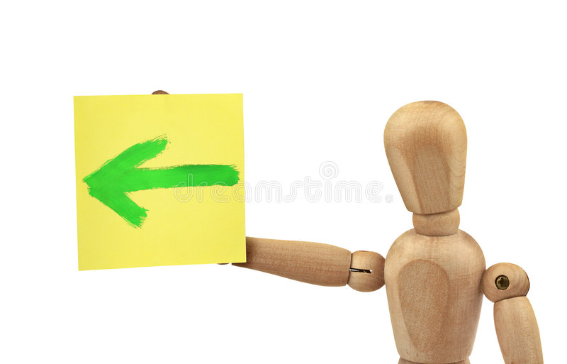 Hombre con la señal de dirección imagen de archivo libre de regalías