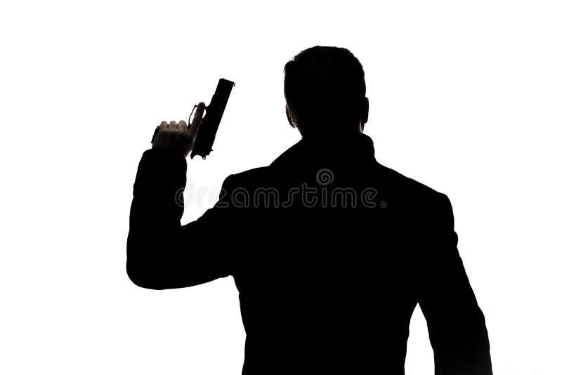 Hombre con la silueta del arma imagen de archivo