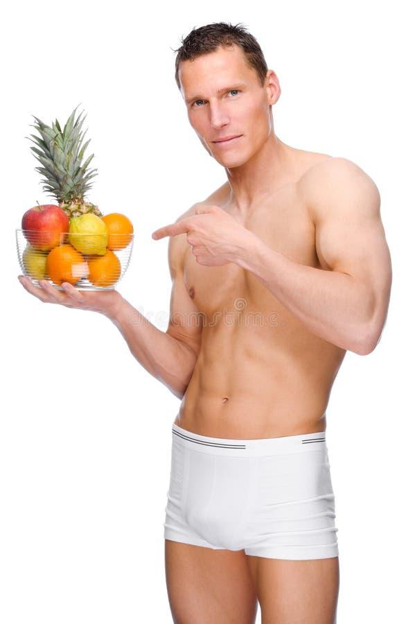 Hombre con las frutas imagen de archivo libre de regalías