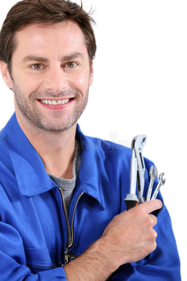 Hombre con las llaves inglesas fotos de archivo