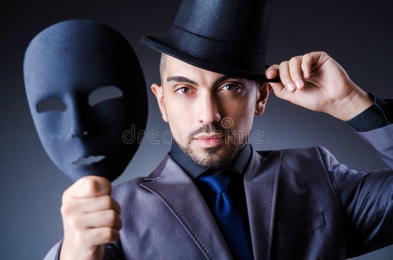 Hombre con las máscaras fotos de archivo libres de regalías