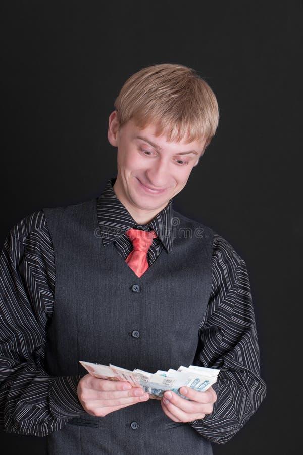 Hombre con los billetes de banco fotos de archivo