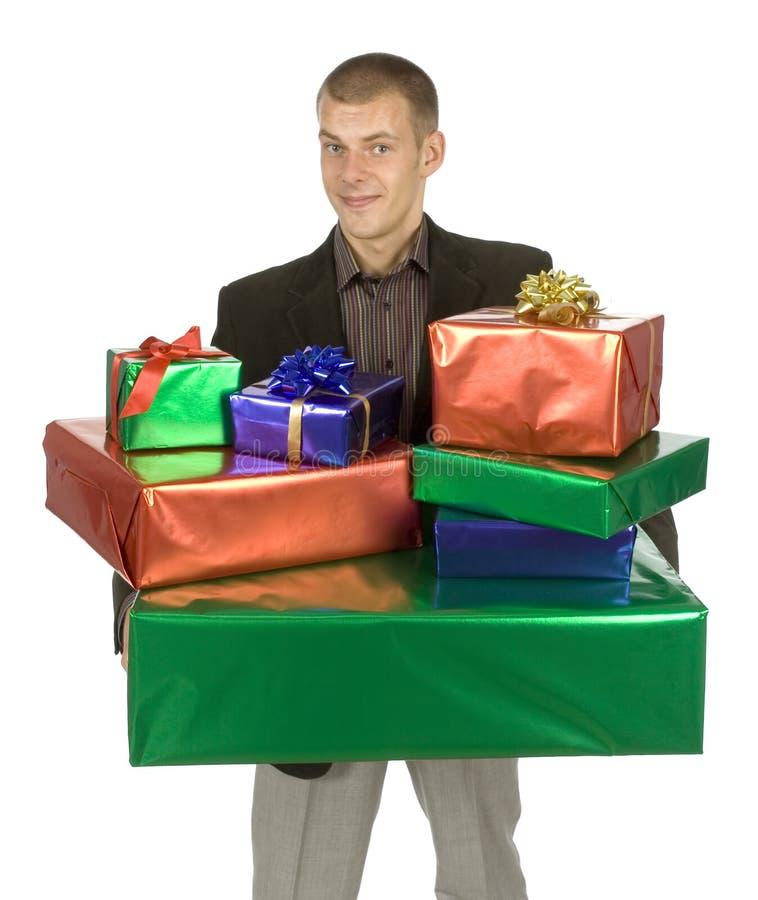 Hombre con los regalos fotos de archivo libres de regalías