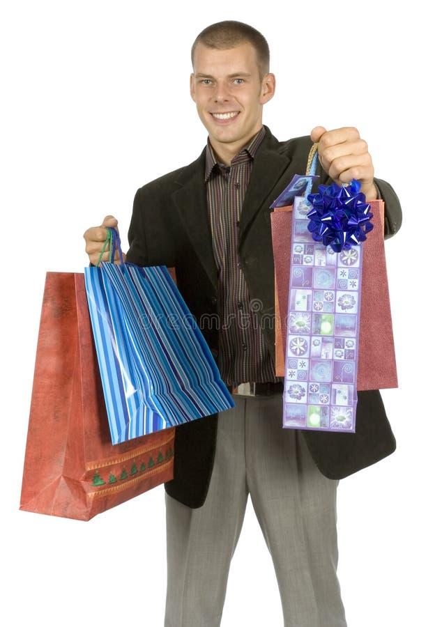Hombre con los regalos imagenes de archivo