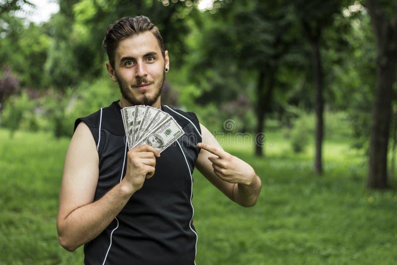 Hombre con muchos dólares imagenes de archivo