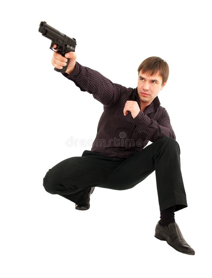 Hombre con un arma fotos de archivo libres de regalías