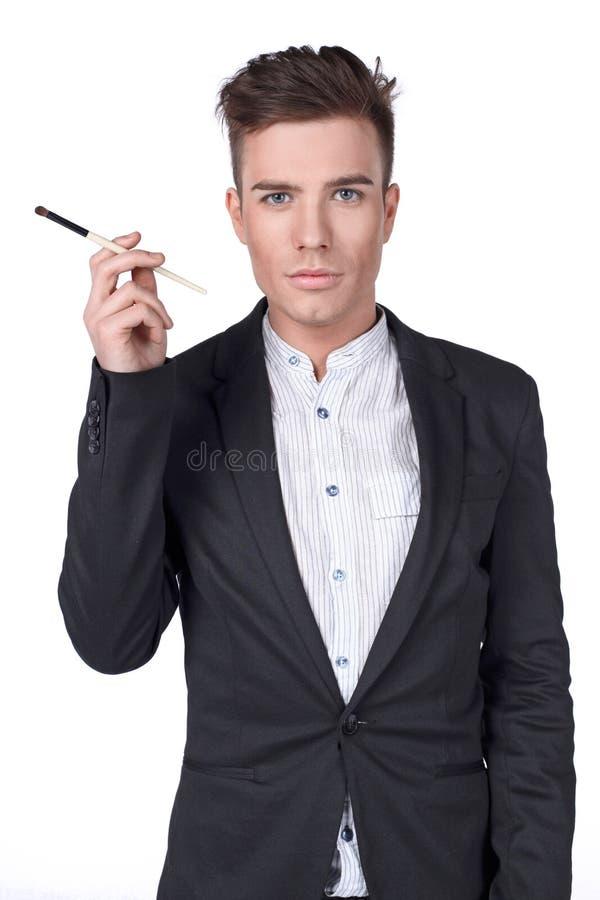 Hombre con un cepillo. fotografía de archivo libre de regalías