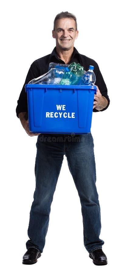 Hombre con un rectángulo de reciclaje imagenes de archivo