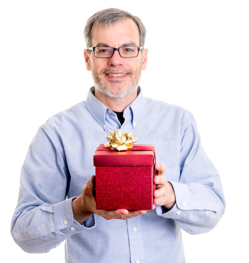 Hombre con un regalo de la Navidad fotos de archivo