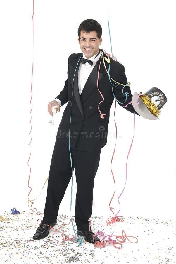 Hombre con un vidrio del champán en una igualdad del Año Nuevo foto de archivo libre de regalías