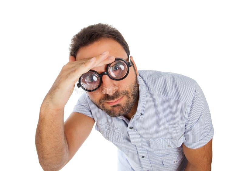 Hombre con una expresión sorprendida y vidrios gruesos fotos de archivo libres de regalías