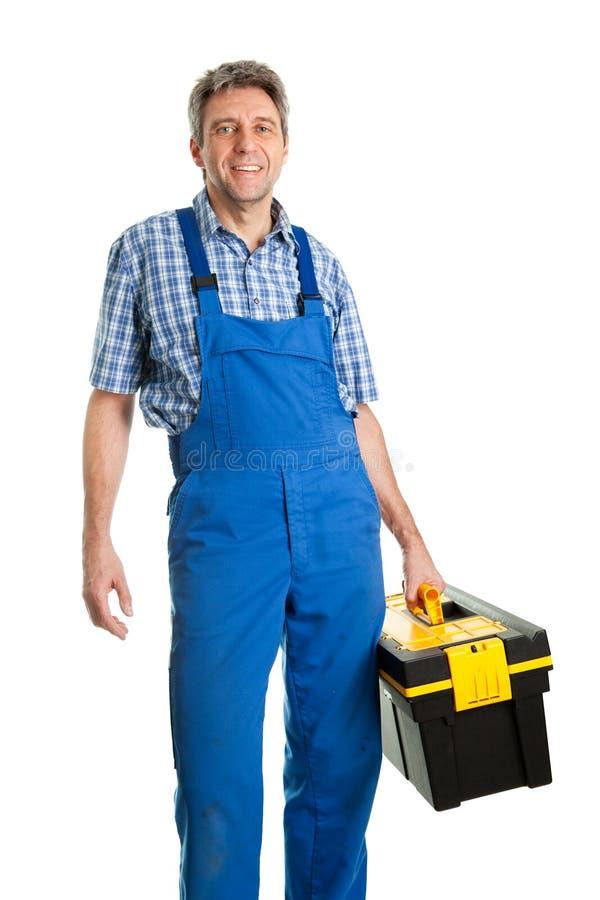 Hombre confidente del servicio con la caja de herramientas imagen de archivo