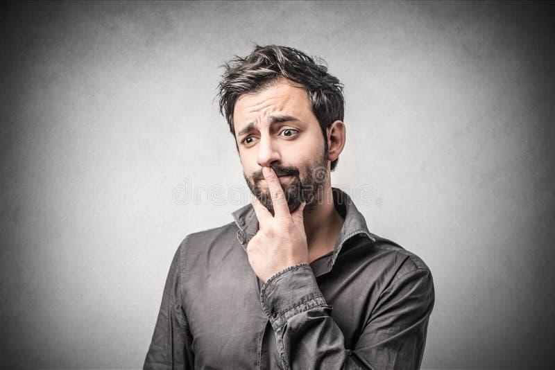 Hombre confuso imagen de archivo