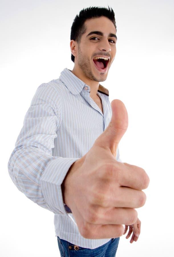 Hombre contento que desea el goodluck foto de archivo libre de regalías