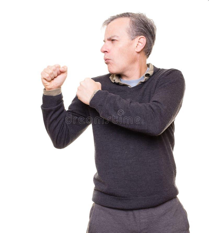 Hombre de encajonamiento o que lucha imagen de archivo