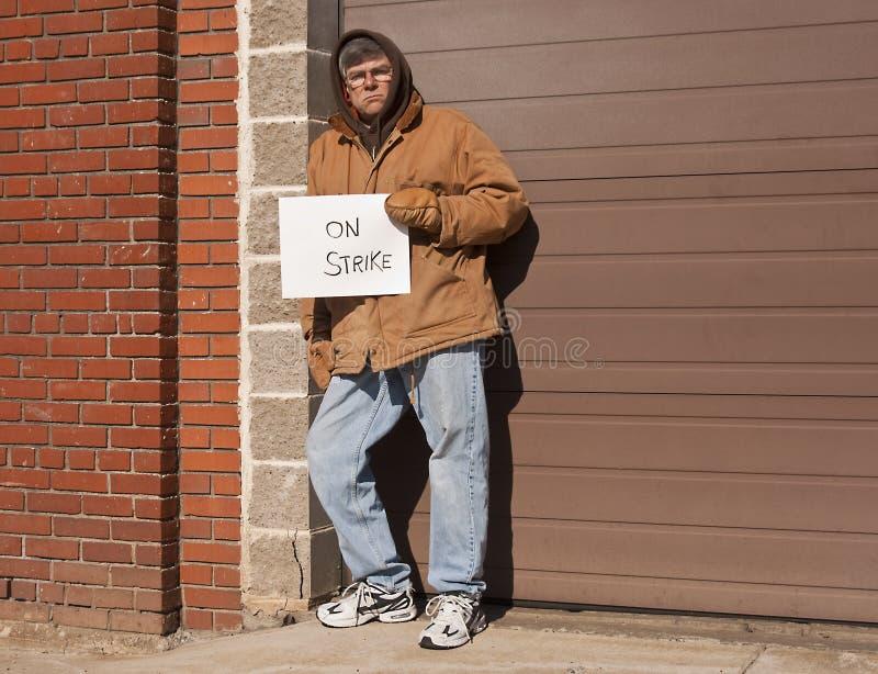 Hombre de funcionamiento en huelga foto de archivo libre de regalías