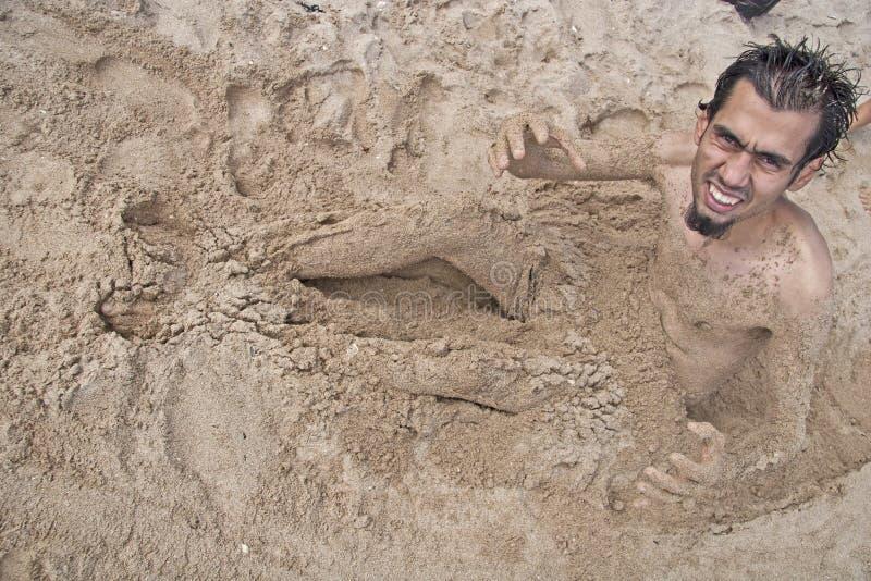 Hombre de la arena foto de archivo libre de regalías