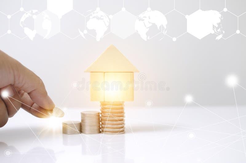 Hombre de la mano que pone monedas de la pila con la casa de bloques y el gr?fico de madera del mapa del c?rculo de la tierra del libre illustration