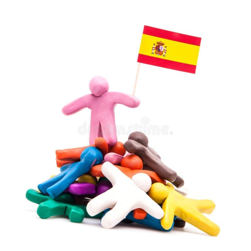 Hombre de la plastilina con la bandera española imagen de archivo