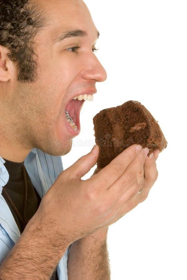 Hombre de la torta de chocolate fotos de archivo