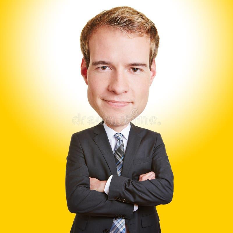 Hombre de los asuntos divertidos con la cabeza grande imagen de archivo
