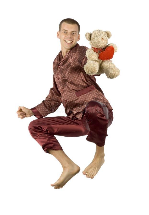 Hombre de los pijamas del vuelo imagen de archivo