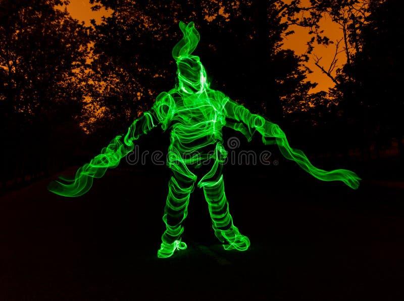 Hombre de luz en el bosque imagen de archivo libre de regalías