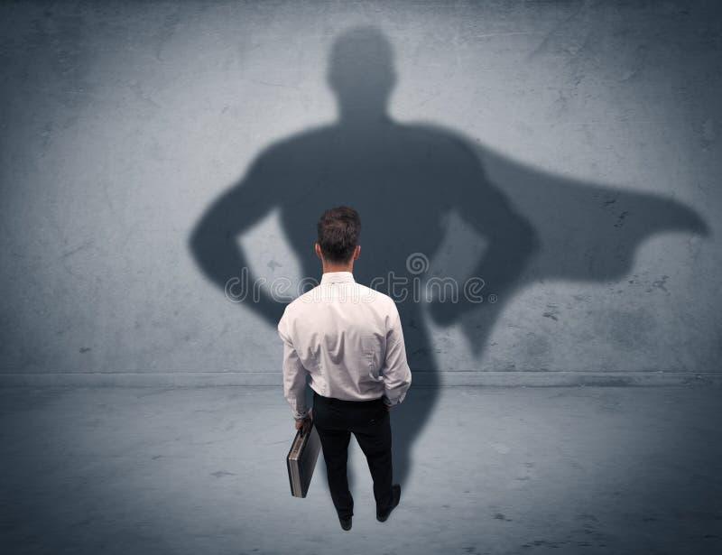 Hombre de negocios acertado con la sombra del super héroe fotografía de archivo libre de regalías