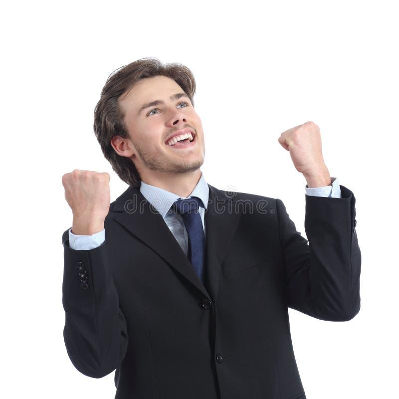 Hombre de negocios acertado eufórico que aumenta los brazos fotografía de archivo libre de regalías