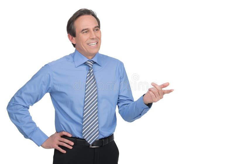 Hombre de negocios acertado. Hombre de negocios maduro hermoso que gesticula el wh fotos de archivo