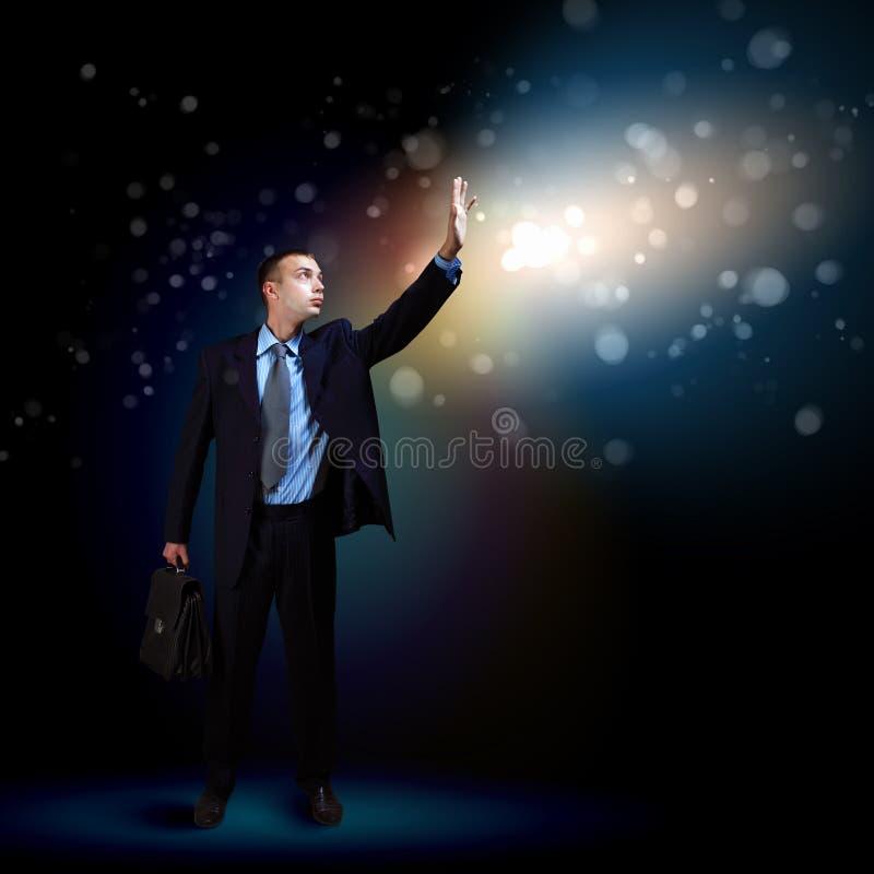 Hombre de negocios con el brillo ligero imagen de archivo