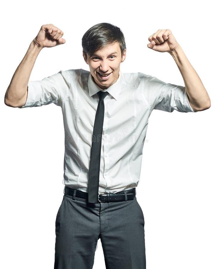 Hombre de negocios acertado que hace gesto de la victoria imágenes de archivo libres de regalías