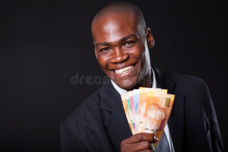Hombre de negocios africano con efectivo fotos de archivo libres de regalías