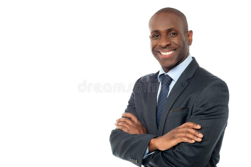 Hombre de negocios africano que mira la cámara foto de archivo libre de regalías