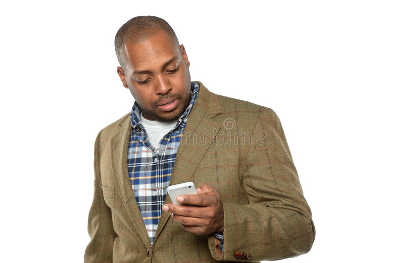 Hombre de negocios afroamericano Using Cellphone fotografía de archivo libre de regalías