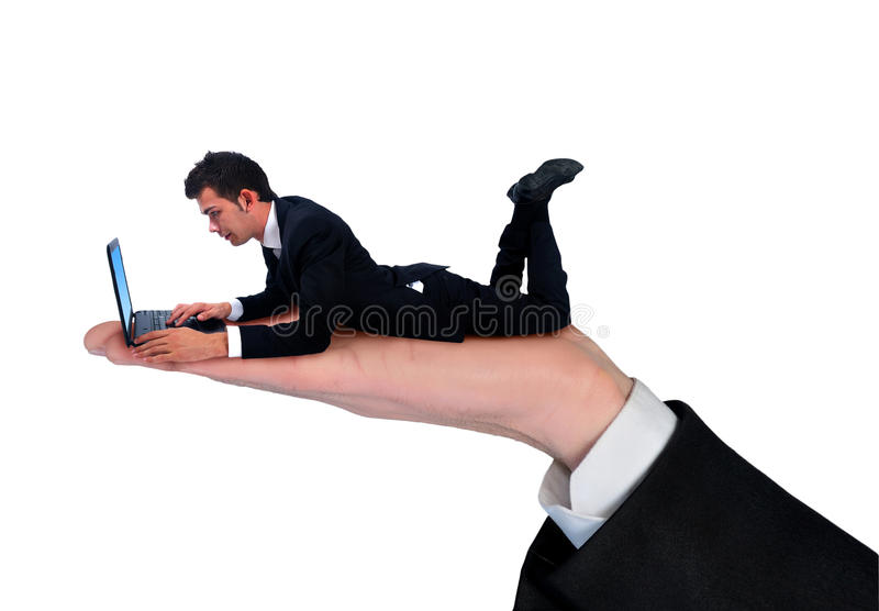 Hombre de negocios aislado que usa el ordenador imágenes de archivo libres de regalías