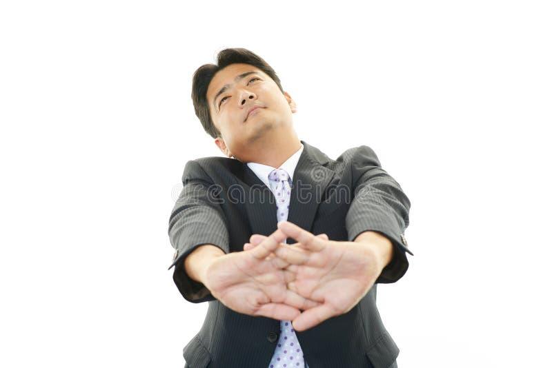 Hombre de negocios asiático cansado fotografía de archivo
