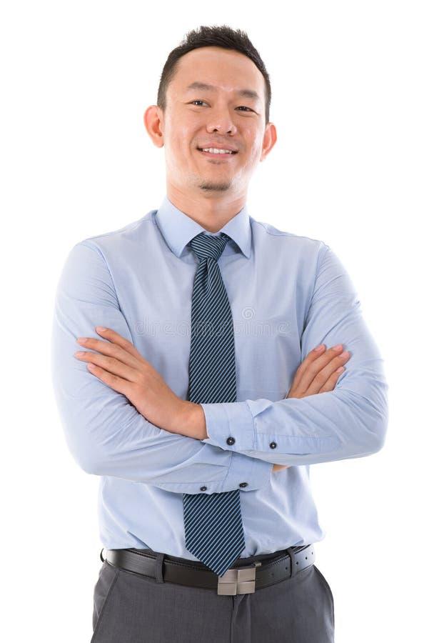 Hombre de negocios asiático confidente foto de archivo