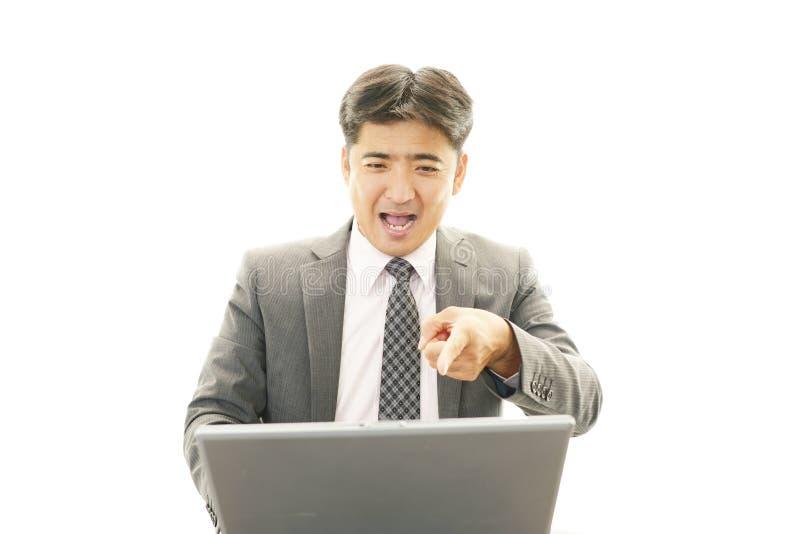 Hombre de negocios asiático de trabajo imagenes de archivo