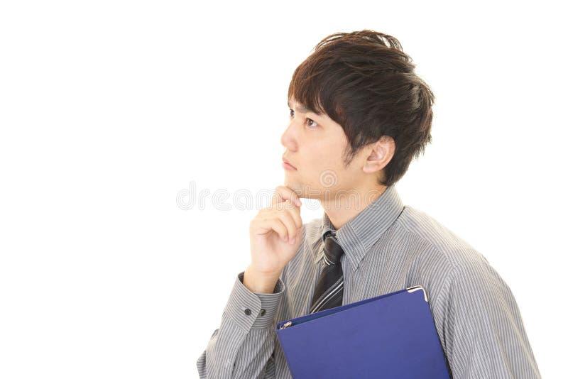 Hombre de negocios asiático difícil fotos de archivo
