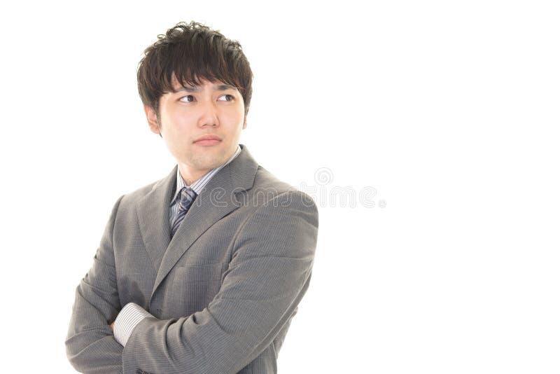 Hombre de negocios asiático difícil foto de archivo
